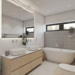 jasna łazienka z szarymi płytkami na ścianie, duże podświetlane lustro do łazienki, łazienka z dwiema umywalkami