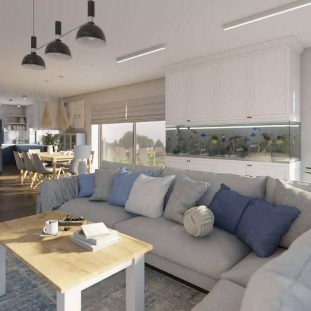 duży salon z jadalnią, stolik kawowy z drewnianym blatem, jak dobrać poduszki do sofy w salonie