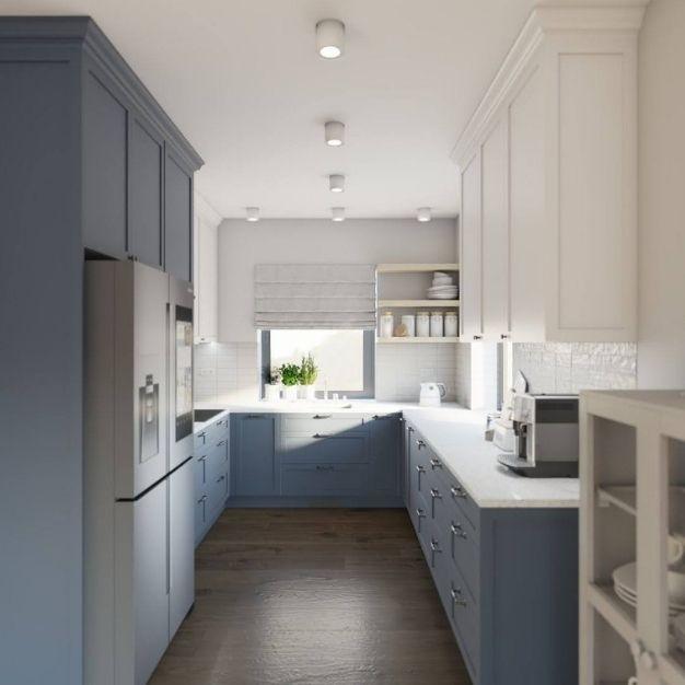 granatowe szafki do kuchni, biały blat kuchenny, szare płytki podłogowe w kuchni